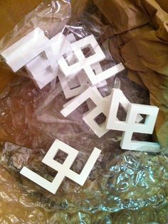 @Danika Herrick, founder of the fantastic company O'verlays, to ask if they had anything that would suss up an IKEA VITTSJO shelving unit . A week later, these arrived: greek key corners! via Sanity Fair blog