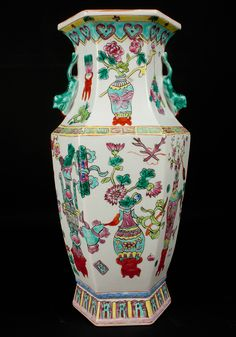 Description A Chinese ' famille rose ' hexagonal vase With twin animal handles, painted in pastel enamels with emblems and flowers  Date Mid nineteenth century  www.collectorstrade.de
