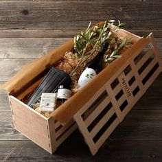 'The Olive Crate' williamssonoma ... click on picture, I love their gardening display ideas (the crate is lined with moss as a herb planter)