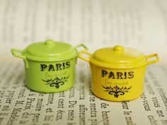 "Brightly colored miniature ""Paris"" cooking pots"