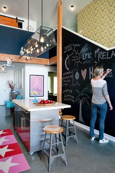HGTV invites you to take a look at this modern loft kitchen with a chalkboard wall, yellow patterned wallpaper, industrial lighting and a metal kitchen island. Loft Kitchen, Eclectic Kitchen, Kitchen Decor, Kitchen Interior, Design Kitchen, Kitchen Colors, Küchen Design, Home Design, Interior Design