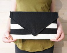 Striped black-ivory clutch