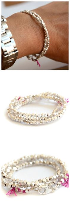 This double faceted wrap bracelet is made with pure silver nugget beads and will wrap around your wrist two times. It is strung together with a silk cord and closed off with a sterling silver clasp. D