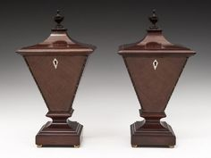 Urn Tea Caddies /  A stunning pair of Edwardian Mahogany Urn Tea Caddies with pagoda tops, turned finial and edged with a decorative wooden moulding. The Edwardian Urn sides & front are beautifully veneered with quartered veneered mahogany having a diamond shaped bone escutcheons, the tapered sides sit on a shaped moulded plynth which has four gilded brass feet.  Offered By Hampton Antiques $7,322.32 //  - Maria Elena Garcia -  ► www.pinterest.com/megardel/ ◀︎