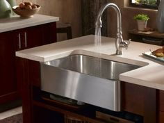 I HATE leaning forward to wash my dishes.  The best thought I've come up with so far is to remove the lip between you and sink, and to pull the faucet as far forward in the sink as possible.  Any other ideas?