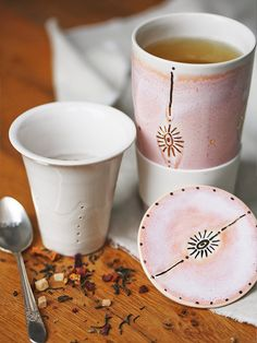 To Go Tea Steeping Mug | Handmade in America, this ceramic to-go mug features a tea strainer and lid for easy on-the-go use. Beautifully handpainted with touches of gold luster, and glazed for a soft finish.
