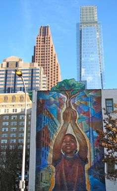 """Mural in Philly - titled """"Reach High and You Will Go Far"""" which is located at 20th & Arch Street."""