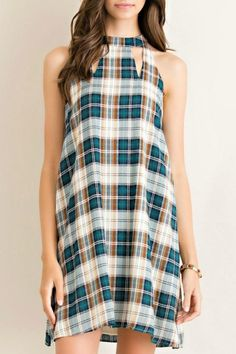 This dress features a high neckline, sleeveless sleeve, and a plaid pattern! Wash in cold water, do not bleach, line dry.   Wish Dress by Entro. Clothing - Dresses - Casual Mississippi