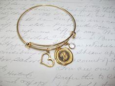 Gold bangle initial bracelet with heart and crystal charms de la boutique BijouxdeBrigitte sur Etsy