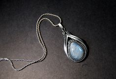 Rainbow moonstone pendant, wire wrapped, sterling silver by Draadjuwelen on Etsy https://www.etsy.com/listing/177527101/rainbow-moonstone-pendant-wire-wrapped