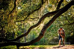 Couple kissing under the boughs of a huge oak tree | Lichgate Park in Tallahassee, Florida | Indoor Engagement Sessions | Scott & Kirsti | Elizabeth Davis Photography | Click here to see the all the photos: http://elizabethdavisphotoblog.com/scott-kirsti-engagement-session/