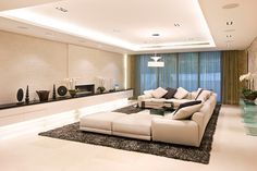 Very chic, modern and minimalist interior design. Great use of colors and vertical draperies that are transparent in the center...
