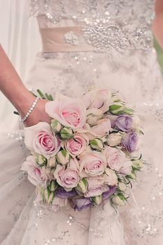 Sweet Avalanche, Memory Lane and Spray Roses were used to create this stunning Bouquet....by Wedding and Events Floral Design www.weddingandevents.co.uk image by Wooden Hill Images