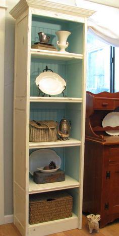 Bi-fold Doors Become A Bookshelf - like the inside paint