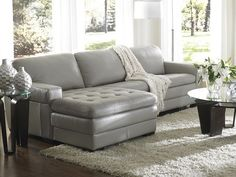 Create an atmosphere thats out of this world with this sectional. Made with semi–aniline, top–grain leather and matching splits. The attached cushions are tufted and feature self–welting. The back cushions are fiber–filled while seat cushions are 1.9–density foam wrapped in polyurethane. Webbing is used for support. The banded base and block feet provide a sleek transition.