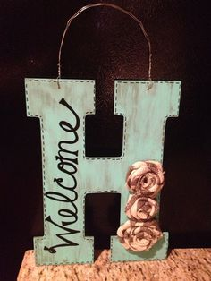 Initial to hang on the front door