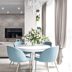 Modern Dining Table Best Tips on a Modern Dining Table Modern Dining Table. A modern dining table is quite different from the traditional ones with respect to various features. The design is one of… Home Living Room, Living Room Decor, Dinner Room, Modern Dining Table, Round Table With Chairs, Coloured Dining Chairs, Small Chairs, Blue Chairs, Kitchen Dining
