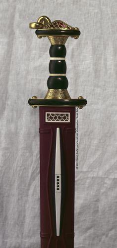 German Spatha hilt from wood and gilt bronze, cloisonne pommel. 6th Century. Blade: Schretzheim, Germany Hilt: Väsby, Sweden