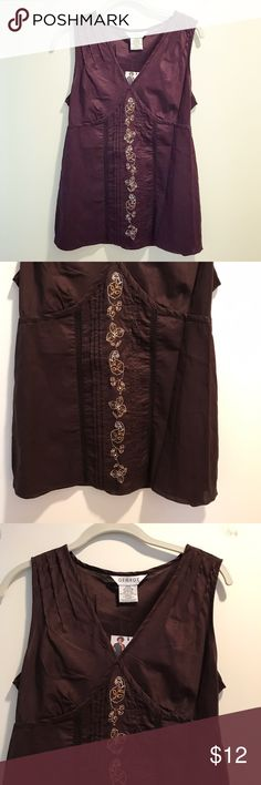 Brown woven & embroidered floral cotton tank top Brown tank top with an embroidered floral pattern (in beige, white, and taupe) sewn down the front panel, with two woven thin panels (that are see-through) on either side of the embroidery. The shirt is made of 100% cotton. There is a tied sash in the back for added fit. This shirt is new with tags, and never been worn. Perfect to wear on a casual day in the summer or with a sweater/blazer at work in the office! George Tops Tank Tops