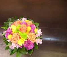 The bride's bouquet was gorgeous with the mixture of bright colors.  Orange roses, burgundy and yellow daisies, pink alstromeria lilies, billy balls, Kermit poms, and salal leaves made for a stunning look. Yellow Daisies, Orange Roses, Billy Balls, Town And Country, Kermit, Bride Bouquets, Lilies, Bright Colors, Daisy