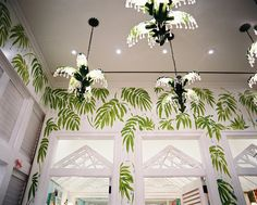 Lighting Photo - Green palm-frond wallpaper with a grouping of chandeliers
