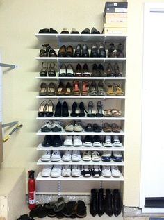 garage shoe storage  Don't think I would store my heels out in the garage though!  Just cleats, boots, flip flops and tennis shoes.