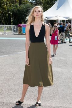 You can achieve the model's colorblock dress look with a low-cut black bodysuit and breezy A-line skirt. Im...