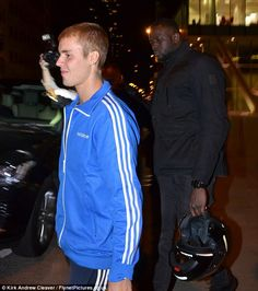 Sporty style: The Sorry singer kept low key in a blue adidas jacket, teamed with matching tracksuit trousers
