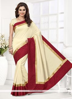 You can be confident to make a powerful style statement with this beige art silk designer saree. This stunning attire is displaying some incredible embroidery done with patch border work. Comes with m...