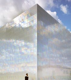 What a pearl! This gorgeous iridescent building creates amazing reflections