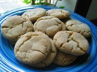 This is my husbands grandmothers recipe that is cherished by the family. They are the best cookie that melts in your mouth. They dont have the normal peanut butter fork crossing...but more of a crackled sugar type cookie... My husband comes from a huge family - and these are one of the cherished recipes!!