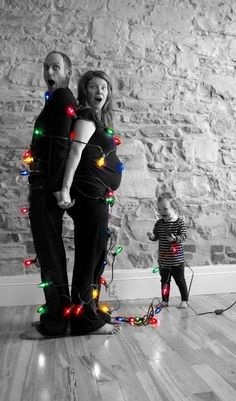 "Christmas card photo. by catalina - Except I would ""tie"" the kids up with the lights."