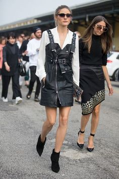 Olivia Palermo Street Style - Leather overall dress with white blouse and ankle boots.