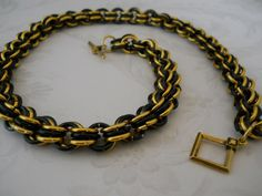 Just listed this chain maille necklace for sale: http://www.bonanza.com/listings/Black-Gold-Chain-Maille-Necklace-My-Design-Featured-in-BeadStyle-Magazine/138105895