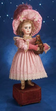 French Automaton Girl with a pet rooster. Tete Jumeau View Catalog Item - Theriault's Antique Doll Auctions