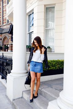 a lovely outfit featuring a classic denim skirt