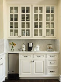 Beautiful Kitchen With Coffee Station Featuring White Cabinets Paired Polished Nickel Hardware And Calcutta Marble