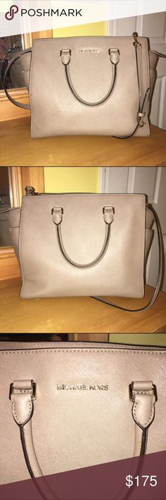 Michael Kors purse. Originally paid $400. Great color - bone. Great condition. Small stain on inside bottom of purse. Always receive a ton of compliments on this purse! Great size - fits 12 inch laptop. Michael Kors Bags Totes