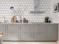 Love the grey cabinets and white subway tile in this modern kitchen Kitchen Dining, Kitchen Decor, Kitchen Cabinets, Gray Cabinets, Kitchen Ideas, Ikea Kitchen Inspiration, Brass Kitchen, Kitchen Walls, Upper Cabinets