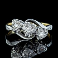 ANTIQUE EDWARDIAN DIAMOND HEART TRILOGY TWIST RING 18CT GOLD PLATINUM CIRCA 1905 front Antique Diamond Rings, Antique Engagement Rings, Diamond Heart, Heart Ring, Twist Ring, Perfect Engagement Ring, Gold Platinum, Edwardian Era, Jewelry Rings