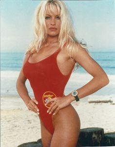 Celebs Channel Pamela Anderson's Iconic 'Baywatch' Swimsuit Style Celebuzz! Michelle Williams, Beach Club, Baywatch Theme, Justin Bieber, Twiggy Model, Pamela Andersen, Meat Dress, Sandy Grease, Lady Madonna