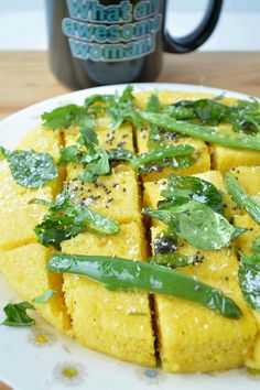 Instant Khaman Dhokla is a steamed cake prepared with chickpea flour and spices. A mouth-watering, nutritious and irresistible Gujarati snack that's actually healthy and vegan! Healthy Indian Recipes, Healthy Eating Recipes, Vegetarian Recipes, Cooking Recipes, Potluck Recipes, Snacks Recipes, Eat Healthy, Cooking Time, Yummy Recipes