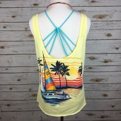 "[Vintage] Beach Graphic Tank Scoop Sunset Boho Top Fun vintage beach tank. Scoop back with graphic on the back. Can be worn the opposite way, would just have a very low cut. Raw hem. Shown layered over a strappy bralette (sold separately). Also makes a cute cover up! No fabric or size tag. Feels like cotton. I think could work for a Small or Medium.  Bust: 19"" Length: 24"" Condition: EUC. No flaws.  No Trades! Vintage Tops Tank Tops"