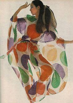 Moyra Swan is wearing a sheer organdie circle printed in giant discs of violet, orange and green by Cardin, photo by Bert Stern, 1969