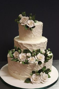 Featured Cake: Alliance Bakery; Elegant three tier textured white wedding cake with white and green detail