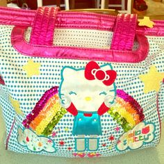 Sanrio Rainbow Rocket Hello Kitty tote bag Adorable HK tote bag. Sequin rainbow adorned in front with button close pocket. Inside multifunction pockets and zipper pocket. Shiny hot pink trim. Star patterned silk lining throughout. Sanrio Bags Totes