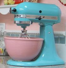 Love the pink bowl with the Aqua Sky mixer! I have this same mixer, now to find a bowl that fits that is pink. Just for decoration of course!
