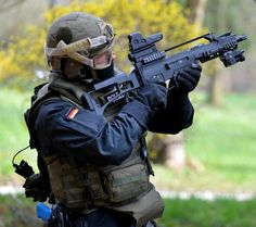 GSG-9 member with a tricked out HK G36C.