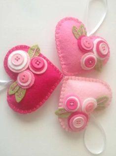 Felt Heart Ornaments with buttonsYou can find Felt hearts and more on our website. Felt Heart Ornaments with buttons Felt Christmas Decorations, Felt Christmas Ornaments, Christmas Crafts, Halloween Crafts, Fabric Crafts, Sewing Crafts, Felt Keychain, Keychain Ideas, Felt Embroidery