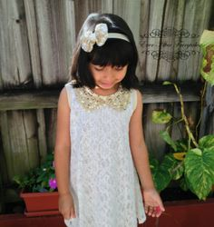 girls white summer dress with peter pan collar. Sequin bow